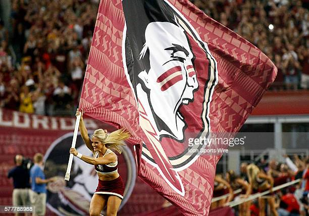 FSU is lead onto the field by the cheerleaders during a NCAA football game between the Florida State Seminoles and the Oklahoma State Cowboys in the...