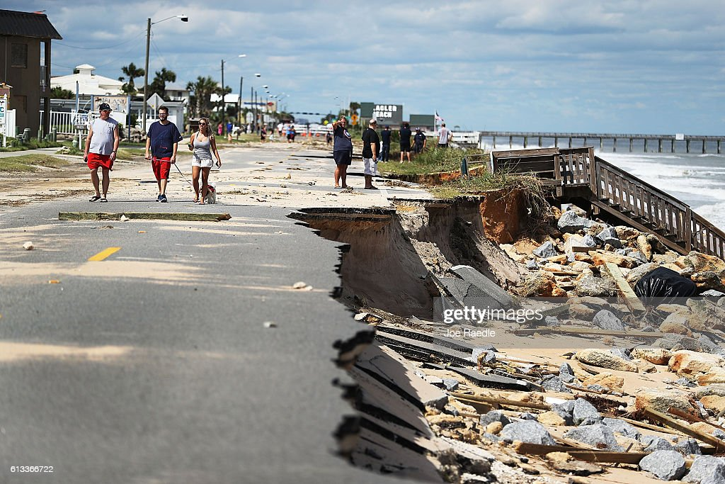 A1A is seen after ocean waters stirred up by Hurricane Matthew washed away the ocean front road on October 8, 2016 in Flagler Beach, Florida. Across the Southeast, over 1.4 million people have lost power due to Hurricane Matthew which was downgraded to a category 1 hurricane on Saturday morning.