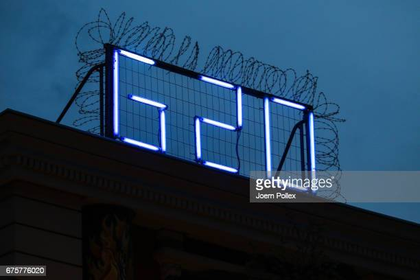 'G20' is seen in fluorescent letters on the top of 'Rote Flora' on May 1 2017 in Hamburg Germany Hamburg will host the G20 summit in July