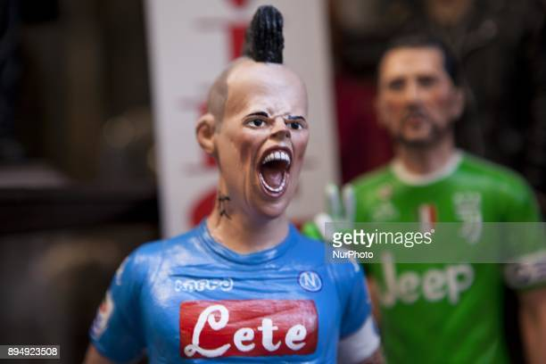 is seen in 'Via San Gregorio Armeno' in Naples Italy on December 18 2017 Various sculptures being sold in Via San Gregorio Armeno a street famous for...