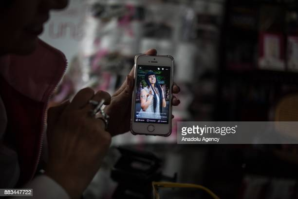 Is seen Luz Angela Merchan showing pictures at her phone about her process with the cancer in Bogota Colombia on November 29 2017 For many women...