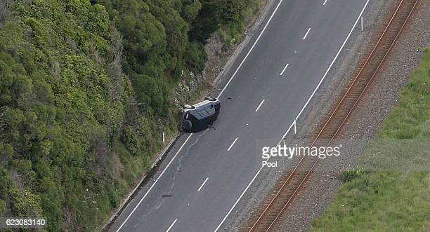 SUV is seen lying on it's side Highway One north of Kaikoura on November 14 2016 in New Zealand The 75 magnitude earthquake struck 20km southeast of...