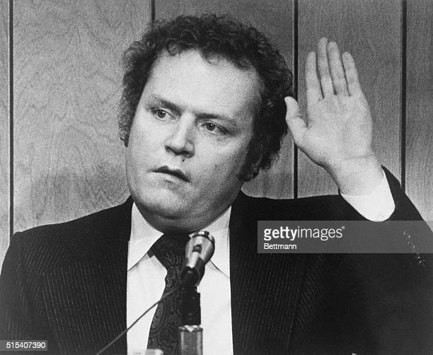 , is shown taking the oath during his trial for obscenity in the Lawrenceville County Courthouse 3/6. Flynt was shot from a passing car as he left a...