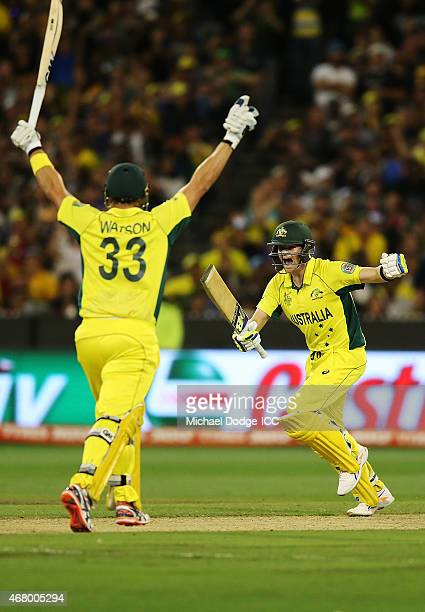 is Steve Smith of Australia and Shane Watson celebrate their win during the 2015 ICC Cricket World Cup final match between Australia and New Zealand...