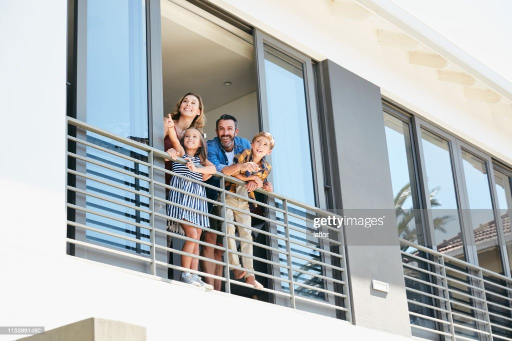 Is that the neighbour? Let's wave hello : Stock Photo