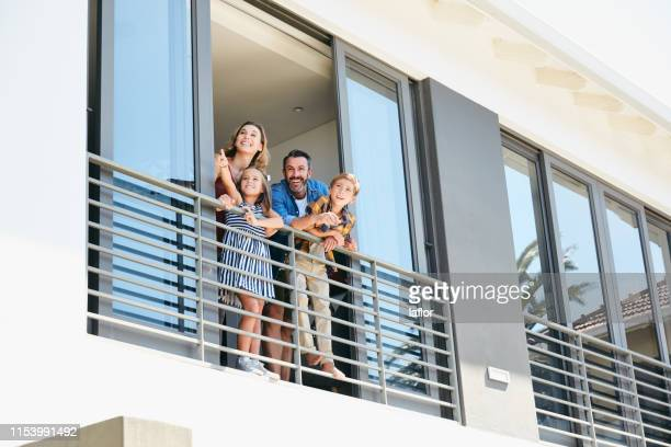 is that the neighbour? let's wave hello - balcony stock pictures, royalty-free photos & images