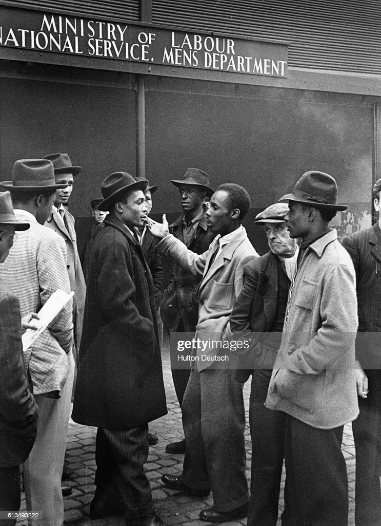 Black Workers Outside Employment Office in Liverpool, 1949 : News Photo