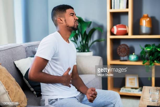 is there a way to stop this pain? - refluxo gastro esofágico imagens e fotografias de stock