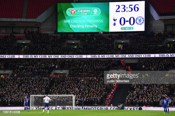 VAR is used to check a penalty decision during the Carabao Cup SemiFinal First Leg between Tottenham Hotspur and Chelsea at Wembley Stadium on...
