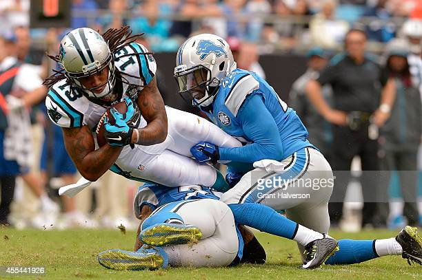Isa AbdulQuddus of the Detroit Lions tackles Kelvin Benjamin of the Carolina Panthers during their game at Bank of America Stadium on September 14...