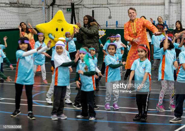 Isa Guha Graeme Swann and Oti Mabuse attend an All Stars Cricket session as part of the ECB's South Asian Action plan Sport England funding...