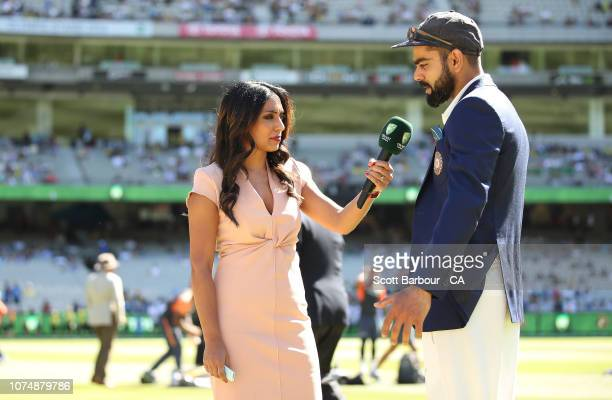 Isa Guha looks interviews Virat Kohli of India during day one of the Third Test match in the series between Australia and India at Melbourne Cricket...