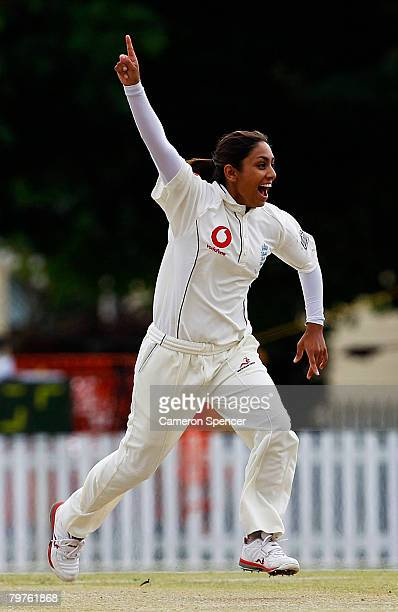 Isa Guha of England celebrates taking the wicket of Alex Blackwell of Australia during day one of the first test between Australia and England held...