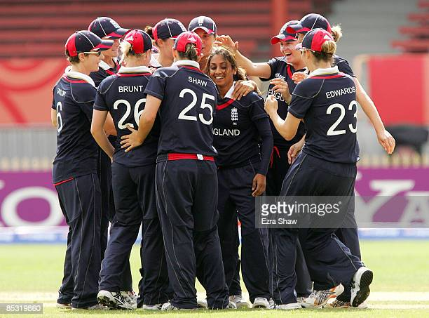 Isa Guha of England is congratulated after she caught MD Thirushkamini of India during the ICC Women's World Cup 2009 round one group stage match...