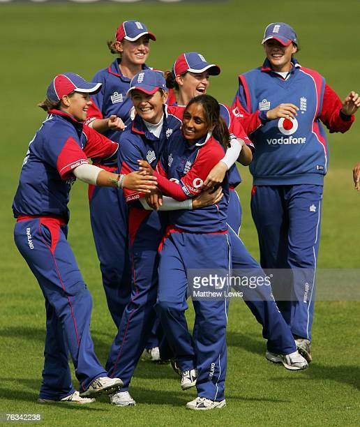 Isa Guha of England is congratulated by Charlotte Edwards after bowling Nicola Browne of New Zealand for LBW during the Fifth One Day International...