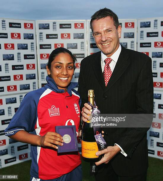 Isa Guha of England recieves the woman of the series after the England v New Zealand Natwest Womens Series One Day International at Old Trafford on...