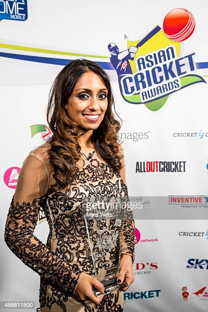 Isa Guha winner of the Media award poses with the trophy during the Asian Cricket Awards at Lords on October 7 2014 in London England