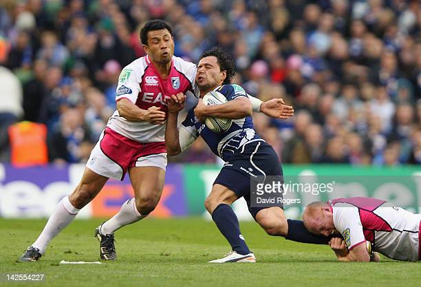 Isa Nacewa of Leinster is tackled by Casey Laulala and Martyn Williams during the Heineken Cup quarter final match between Leinster and Cardiff Blues...