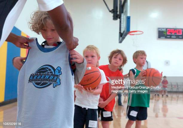 BEACH CALIF USA Isaac Askin gets his jersey on the first day of basketaball camp at the Alpert JCC in Long Beach Calif on July 11 2011 The Pete Davis...