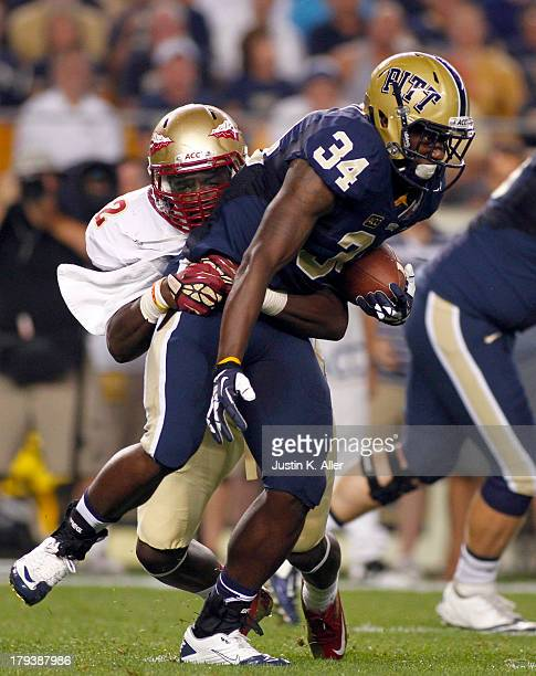 Isaac Bennett of the Pittsburgh Panthers rushes in the first half against Telvin Smith of the Florida State Seminoles during the game on September 2...