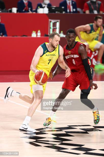 Isaac Bonga of the Germany Men's National Team plays defense on Joe Ingles of the Australia Men's National Team during the 2020 Tokyo Olympics on...