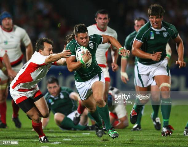 Isaac Boss of Ireland surges away from the tackle of Irakli Abuseridze of Georgia during Match Sixteen of the Rugby World Cup 2007 between Ireland...