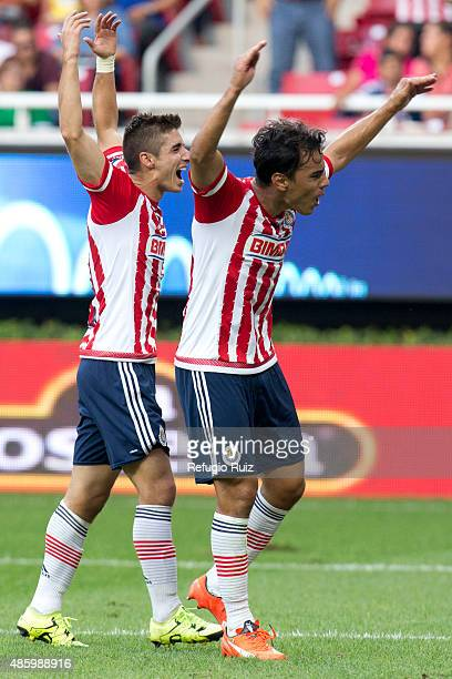 Isaac Brisuela of Chivas celebrates with teammate Omar Bravo after scoring the fourth goal of his team during a 7th round match between Chivas and...