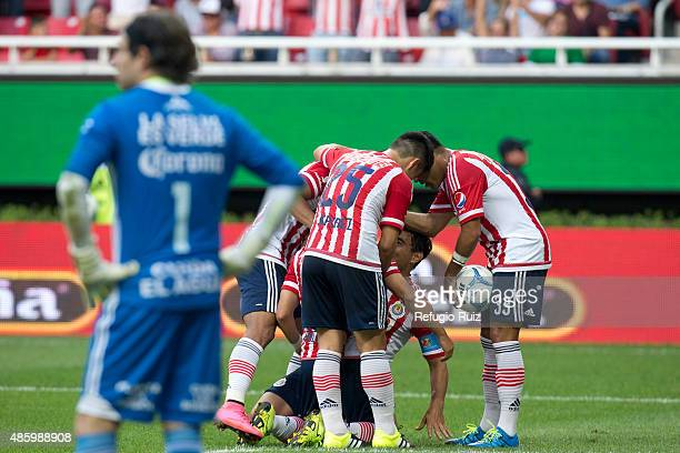 Isaac Brisuela of Chivas celebrates with teammates after scoring the fourth goal of his team during a 7th round match between Chivas and Chiapas as...
