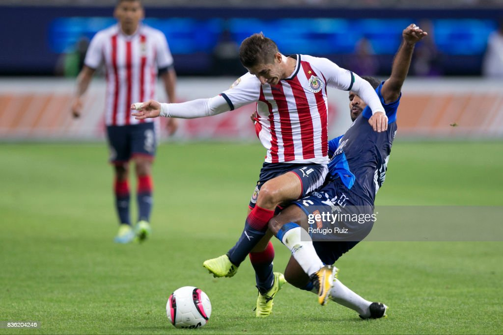 Isaac Brisuela of Chivas fights for the ball with Brayan Angulo of Puebla during the fifth round match between Chivas and Puebla as part of the Torneo Apertura 2017 Liga MX at Chivas Stadium on August 19, 2017 in Zapopan, Mexico.