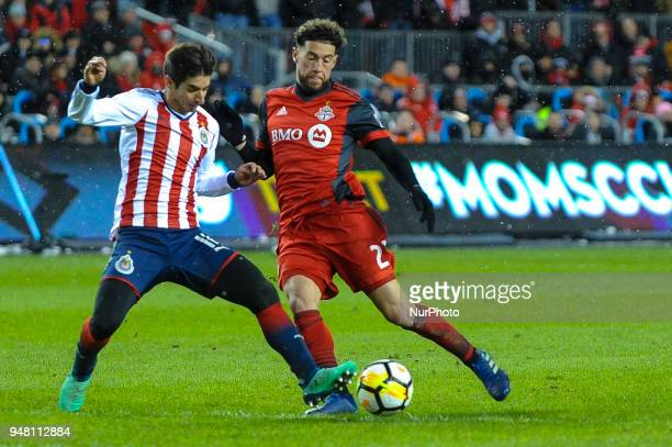 Isaac Brizuela and Liam Fraser bduring the 2018 CONCACAF Champions League Final match between Toronto FC and CD Chivas Guadalajara at BMO Field in...