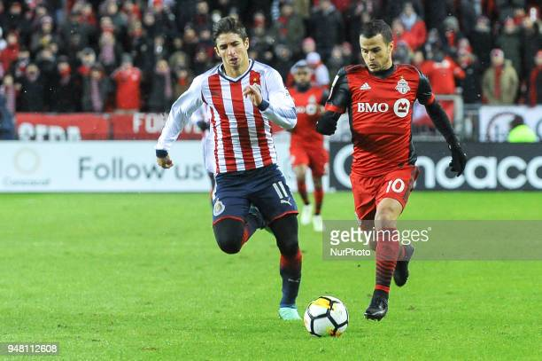Isaac Brizuela and Sebastian Giovinco during the 2018 CONCACAF Champions League Final match between Toronto FC and CD Chivas Guadalajara at BMO Field...