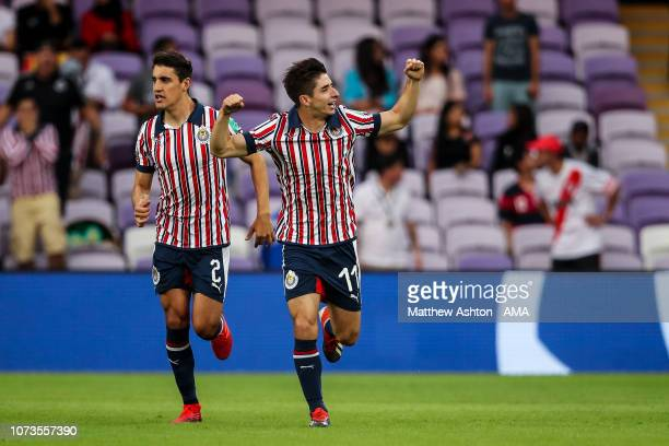 Isaac Brizuela of CD Guadalajara celebrates after scoring a goal to make it 01 during the FIFA Club World Cup UAE 2018 match between Kashima Antlers...