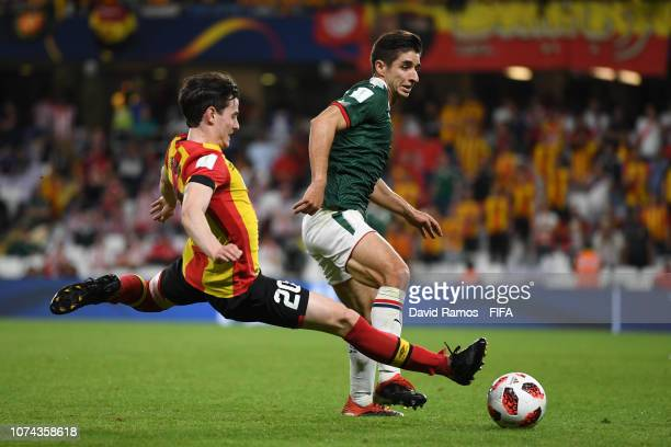 Isaac Brizuela of CD Guadalajara is challenged by Mohammed Belaili of ES Tunis during the FIFA Club World Cup UAE 2018 5th Place Match between ES...