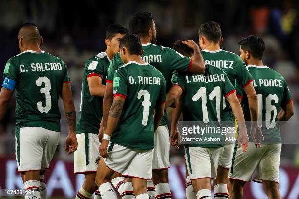 Isaac Brizuela of CD Guadalajara is consoled after he misses his penalty during the FIFA Club World Cup UAE 2018 5th Place Match between ES Tunis and...