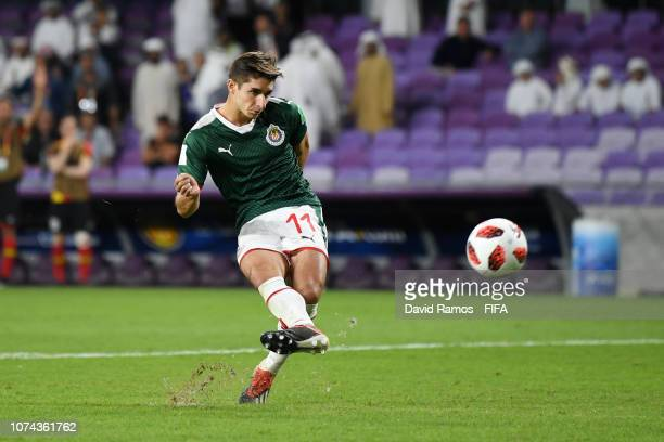 Isaac Brizuela of CD Guadalajara takes and misses a penalty during the penalty shoot out during the FIFA Club World Cup UAE 2018 5th Place Match...