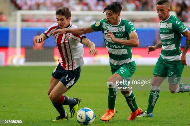 Isaac Brizuela of Chivas and Jose Abella of Santos fight for the ball during the fourth round match between Chivas and Santos Laguna as part of the...