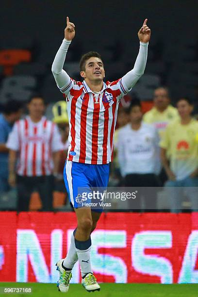 Isaac Brizuela of Chivas celebrates after scoring the second goal of his team during the 7th round match between America and Chivas as part of the...