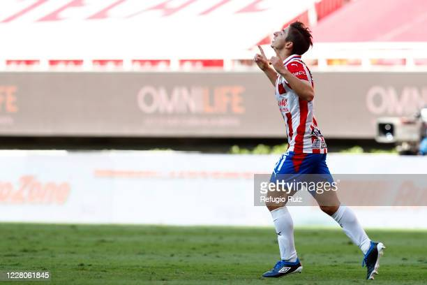 Isaac Brizuela of Chivas celebrates with his teammates after scoring the first goal of his team during the 5th round match between Chivas and...