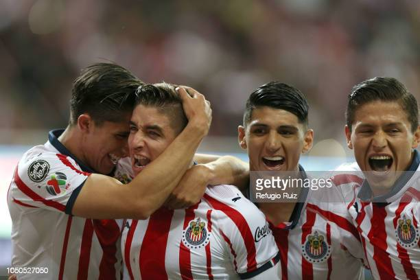 Isaac Brizuela of Chivas celebrates with teammates after scoring the first goal of his team during the 12th round match between Chivas and Pumas UNAM...