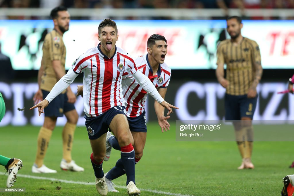 0f3b2de6ea3 Isaac Brizuela of Chivas celebrates with teammates after scoring the ...
