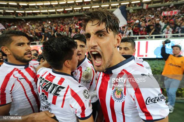 Isaac Brizuela of Chivas celebrates with teammates after scoring the second goal of his team during the first round match between Chivas and Tijuana...