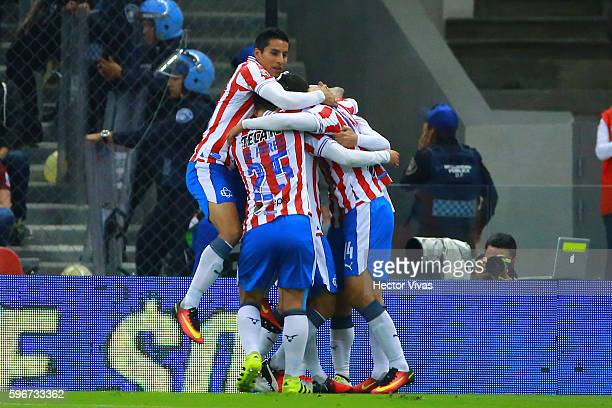 Isaac Brizuela of Chivas celebrateS with teammates after scoring the first goal of his team during the 7th round match between America and Chivas as...