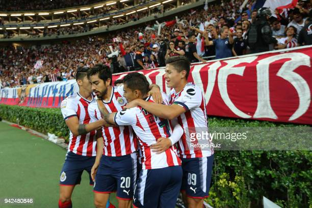 Isaac Brizuela of Chivas celebrates with teammates after scoring the first goal of his team during the semifinal match between Chivas and New York RB...