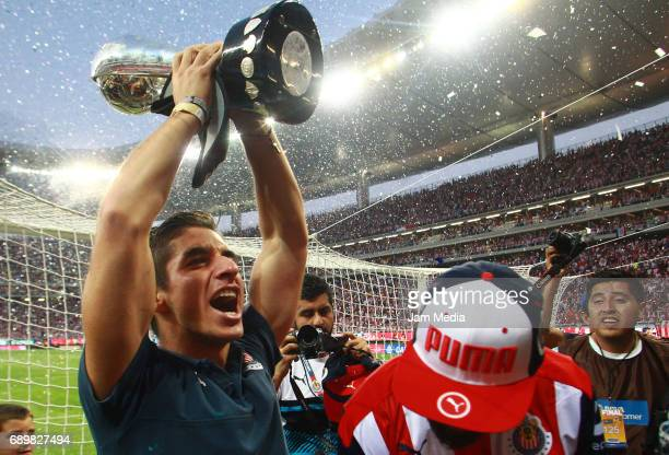 07f5ea12680 Isaac Brizuela of Chivas celebrates with the champions trophy after the  Final second leg match between