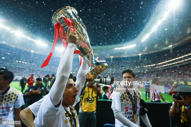 Isaac Brizuela of Chivas celebrates with the champions trophy during the second leg match of the final between Chivas and Toronto FC as part of...