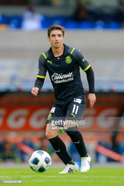 Isaac Brizuela of Chivas drives the ball during the 8th round match between Pumas UNAM and Chivas as part of the Torneo Grita Mexico A21 Liga MX at...