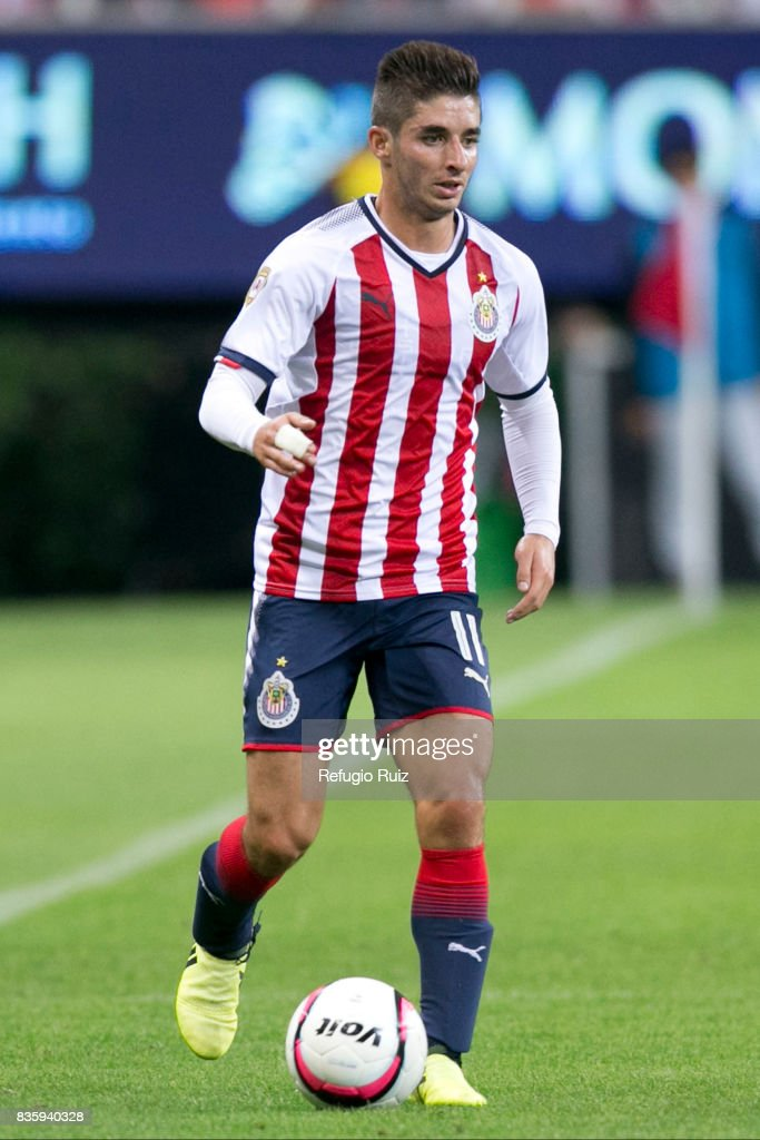 Isaac Brizuela of Chivas drives the ball during the fifth round match between Chivas and Puebla as part of the Torneo Apertura 2017 Liga MX at Chivas Stadium on August 19, 2017 in Zapopan, Mexico.