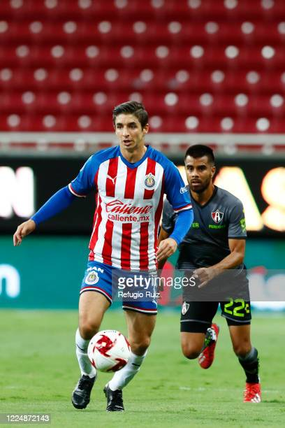 Isaac Brizuela of Chivas fights for the ball with Armando Escobar of Atlas during the match between Chivas and Atlas as part of the friendly...