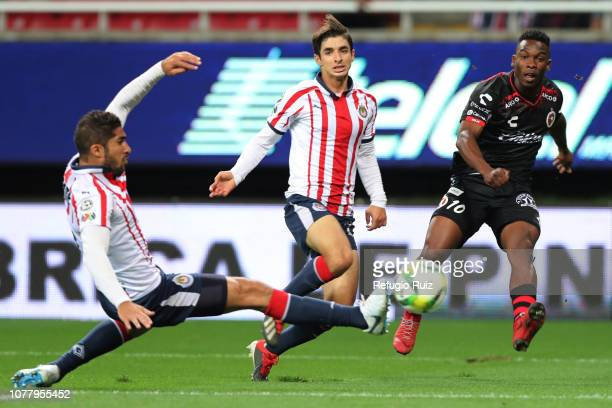 Isaac Brizuela of Chivas fights for the ball with Fabián Castillo of Tijuana during the first round match between Chivas and Tijuana as part of the...