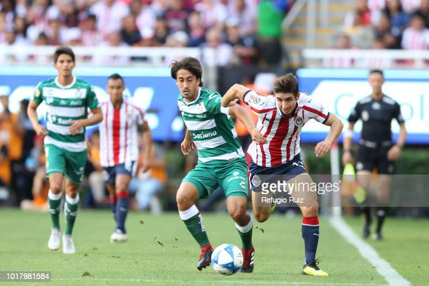 Isaac Brizuela of Chivas fights for the ball with Jose Abella of Santos during the fourth round match between Chivas and Santos Laguna as part of the...
